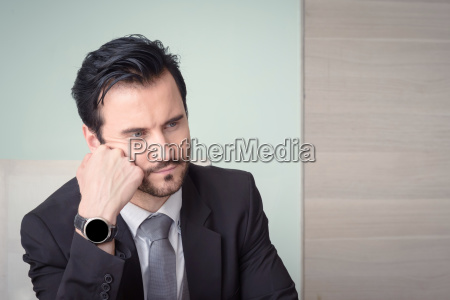 young depressed stressed businessman working at