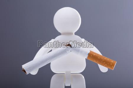 human figure with broken cigarette