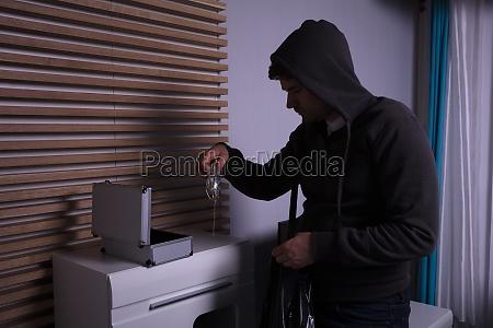 robber standing in living room