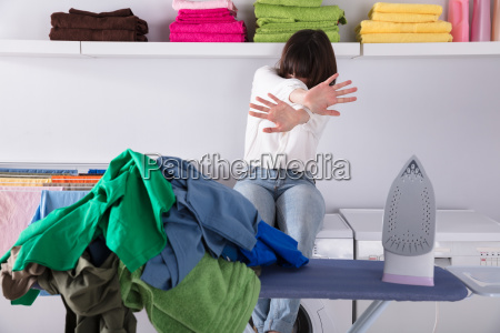 pile of clothes and iron on