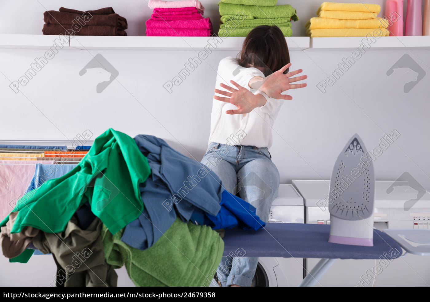 pile, of, clothes, and, iron, on - 24679358
