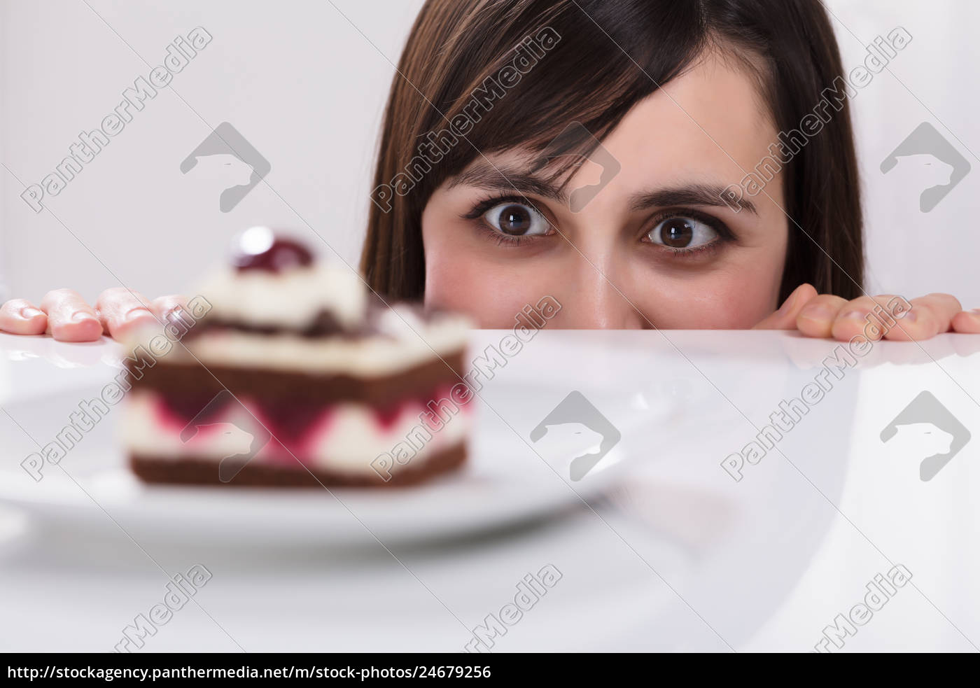 woman, craving, for, slice, of, cake - 24679256