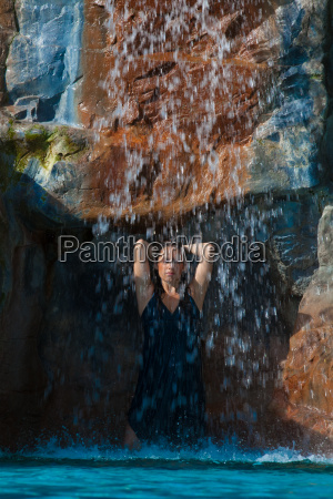 girl under waterfall