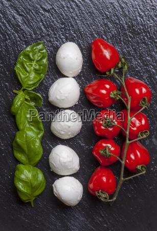 ingredients of insalada caprese on black