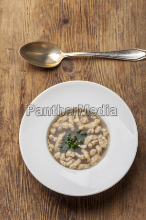 bavarian tan reading soup with spoon