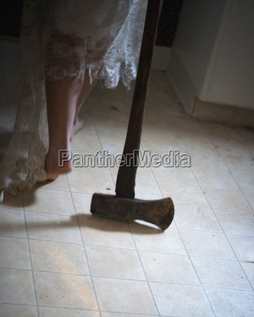 a ax and a womans legs