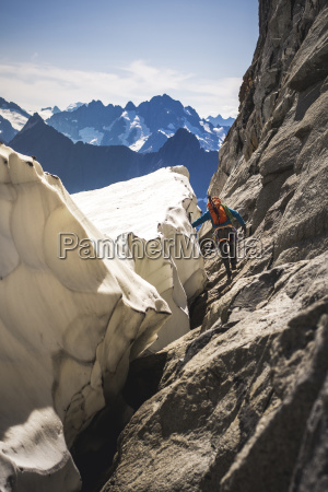 mountain climber walking around glacier bergschrund