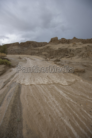 dirt road during flash flood in