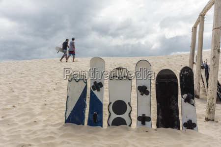 sand boards on sand dunes against