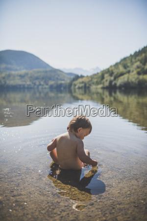baby boy playing in hicks lake