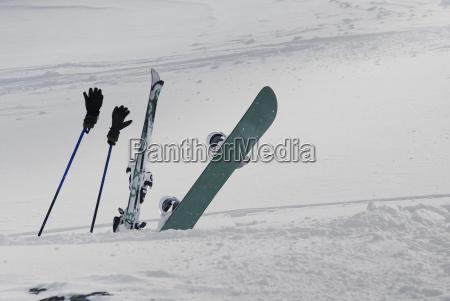 skis ski poles and snowboard struck