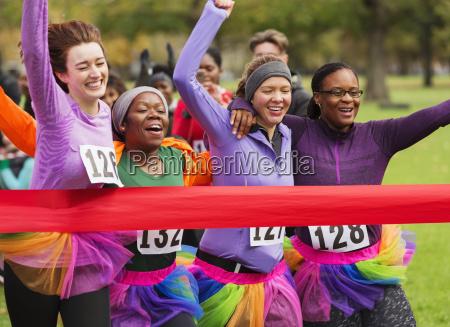 women friend runners in tutus running