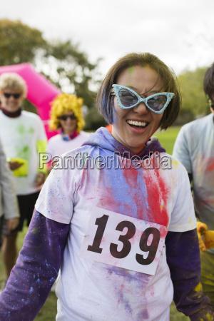 portrait playful female runner in sunglasses