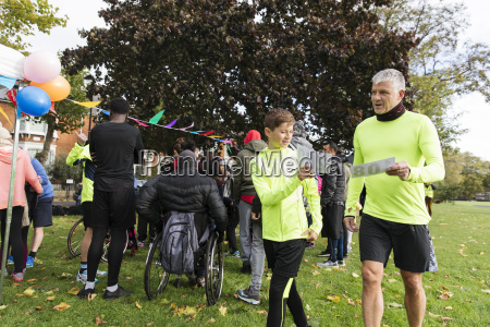 father and son holding marathon bibs