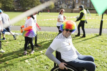 portrait smiling playful man in wheelchair