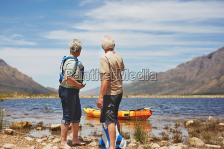 active senior couple preparing to kayak