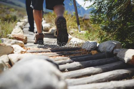 feet of male hiker hiking along