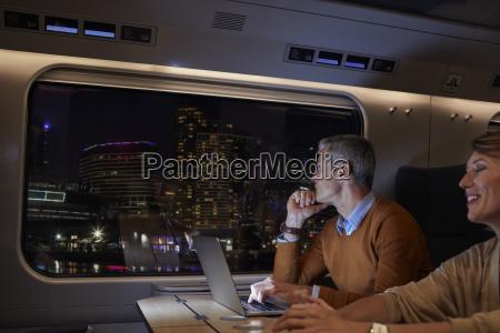 businessman working at laptop on passenger