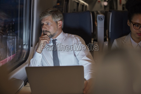 serious thoughtful businessman working at laptop