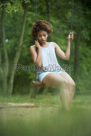 thoughtful young woman sitting on outdoor