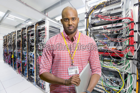 portrait of it technician in data