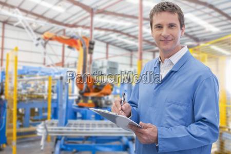 portrait of worker on floor of