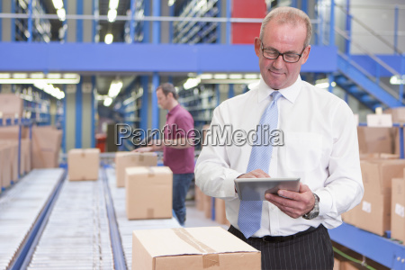 businessman, in, warehouse, dispatch, area, with - 24706842