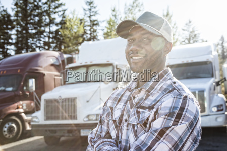 black man truck driver near his