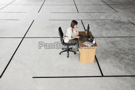 caucasian business woman at desk looking