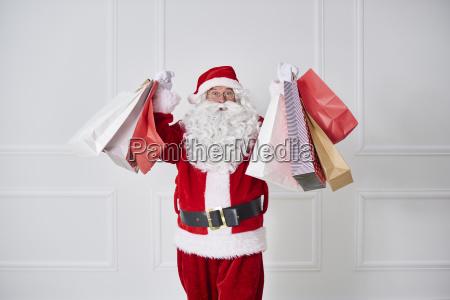 portrait of santa claus holding shopping