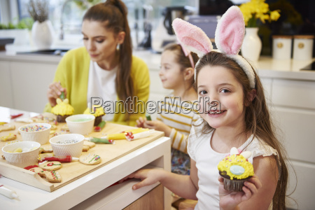 portrait of smiling girl showing easter
