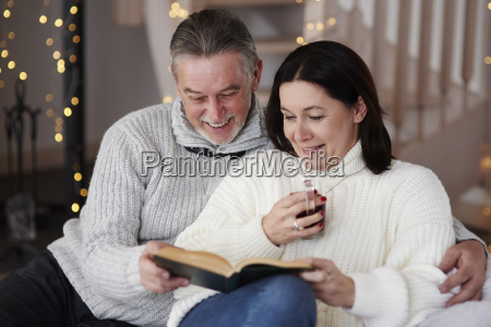 happy mature couple reading a book
