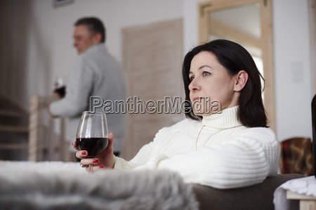 serious mature woman with glass of