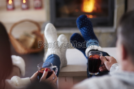 mature couple with hot drinks in