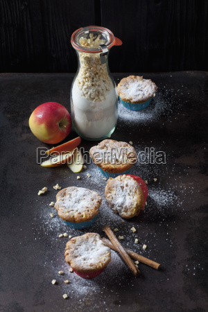 apple cinnamon muffins and glass bottle