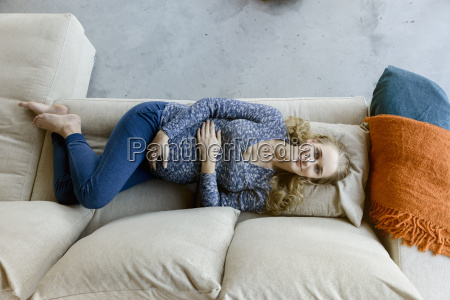 portrait of smiling pregnant woman lying