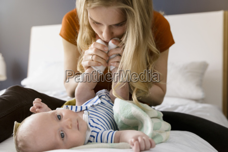 mother kissing baby boys feet