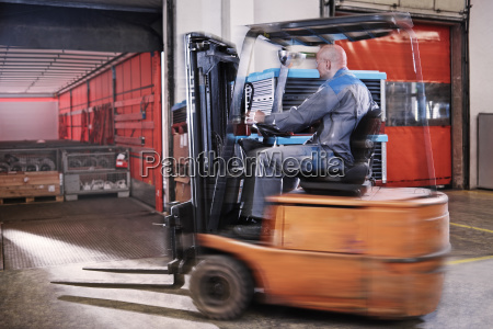 fork lift driver loading lorry