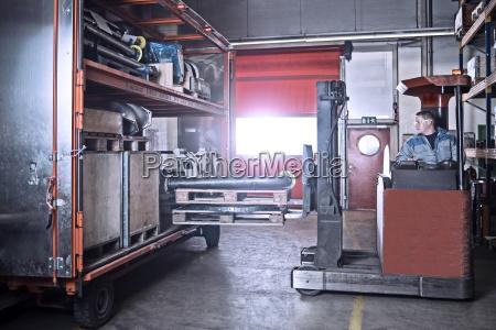 fork lift driver loading trailer