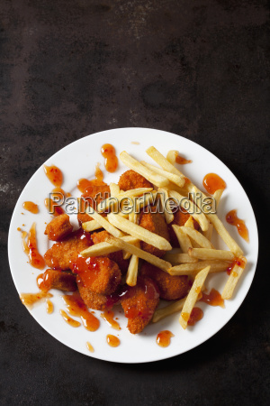 plate of chicken nuggets with sweet