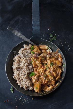 jackfruit goulash with spelt rice in
