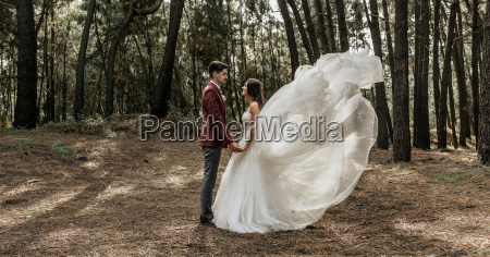 bride with windswept wedding dress and