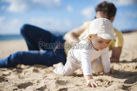spain lanzarote baby girl crawling on