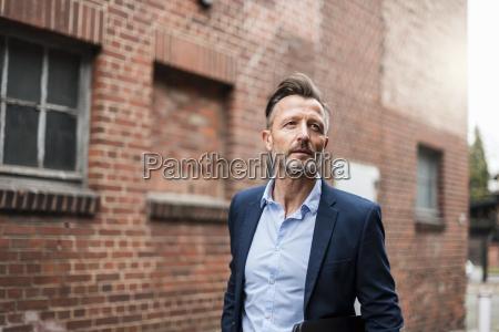 portrait of mature businessman at brick
