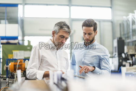 businessmen during meeting with tablet in