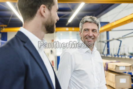 businessmen during meeting in production hall