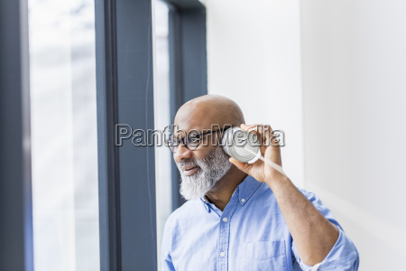 businessman using tin can phone