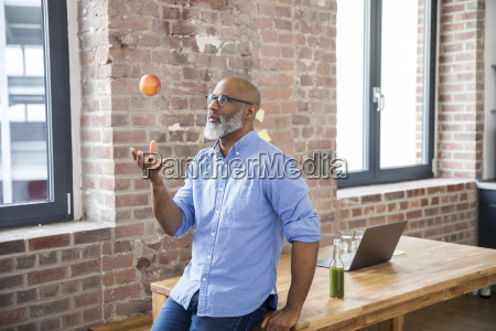 freelancer throwing apple in the air