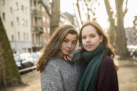 portrait of two best friends wearing