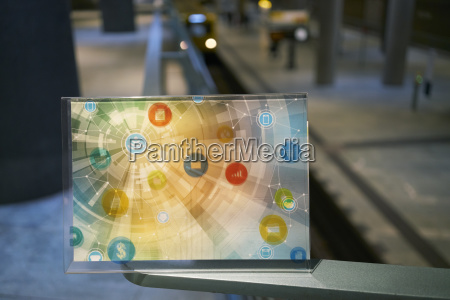 futuristic device with digital icons at